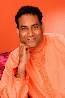 Yogi Dr. Malik, Yoga Teacher (Yogi) and Editor of YOGA Magazine based in London, UK